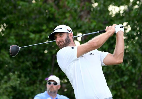 Aug 9, 2019; Jersey City, NJ, USA; Dustin Johnson watches his tee shot on the 17th hole during the second round of The Northern Trust golf tournament at Liberty National Golf Course.