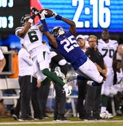 New York Giants cornerback Corey Ballentine (25) intercepts New York Jets wide receiver Tim White (6) in the second half. The New York Giants defeat the New York Jets, 31-22, in the first preseason game at MetLife Stadium on Thursday, August 8, 2019, in East Rutherford.