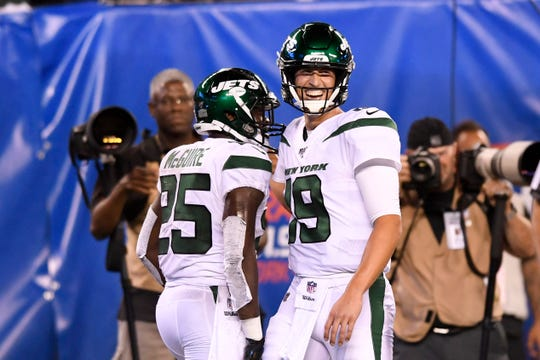 New York Jets running back Elijah McGuire (25) and quarterback Trevor Siemian (19) celebrate their touchdown in the first half against the New York Giants. The Jets face the Giants in the first preseason game at MetLife Stadium on Thursday, August 8, 2019, in East Rutherford.