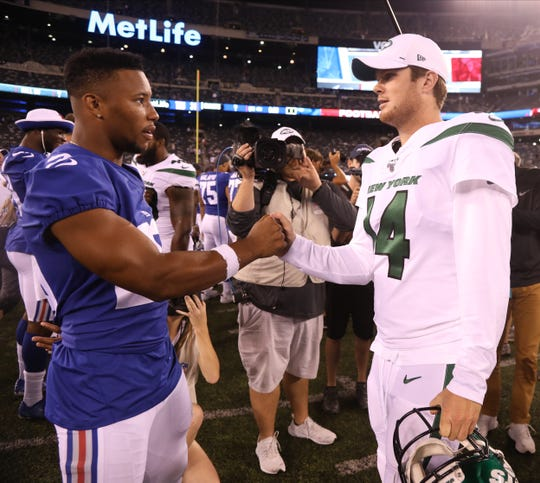 Saquon Barkley of the NY Giants and Sam Darnold of the NY Jets at the end of the game.  The Jets and Giants played in the first pre season game of the 2019 season at MetLife Stadium in East Rutherford, NJ on August 8, 2019.