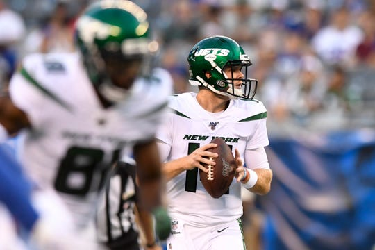 New York Jets quarterback Sam Darnold (14) looks for an open receiver against the New York Giants. The Jets face the Giants in the first preseason game at MetLife Stadium on Thursday, August 8, 2019, in East Rutherford.