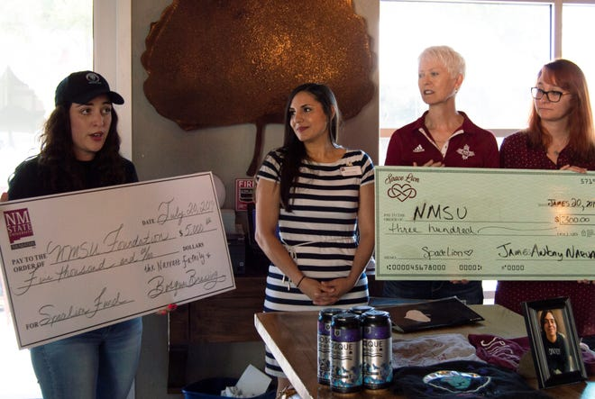 Bosque Brewing Co. and Spacelion for Life gifted $5,300 to the New Mexico State University Foundation for suicide prevention programs. From left, Jess Griego of Bosque Brewing Co., Kassie Ckodre and Elaine Stachera Simon of the NMSU Foundation, and Tiffany Tyson of NMSU Health and Wellness attended the July 20 presentation. The donation will be used to support suicide prevention and outreach provided by the NMSU Health and Wellness department.
