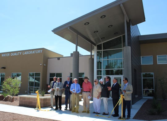 Las Cruces Utlities Board of Commissioners and other dignitaries mark the opening of the new water quality lab, which improves the testing capability of the city's water and wastewater departments.