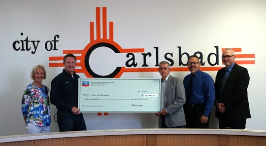 (From left): Cary Baird and Nathan Carroll, with Chevron, present City of Carlsbad Mayor Dale Janway, City Administrator Mike Hernandez and Police Chief Shane Skinner with a $50,000 contribution that will go toward the creation of a City of Carlsbad Bomb Squad.