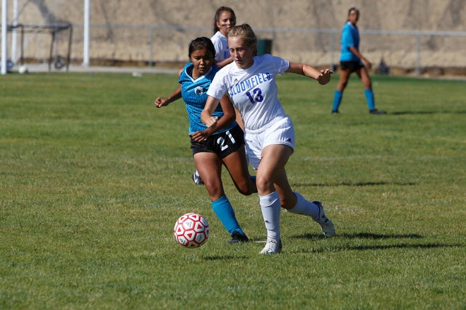 Bloomfield's Cheyanne Radijitis and Navajo Prep's Kalieyah Boyd chase after the ball during a soccer match on Tuesday, Sept. 18, 2018, at Eagle Stadium in Farmington. Bloomfield opens 2019 at the Aztec Tiger Shootout, while Prep opens the new year at the Taos Tournament.