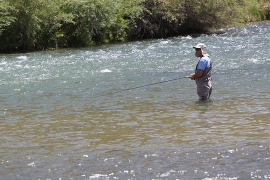 An angler works the Texas Hole on the San Juan River in this 2019 file photo.
