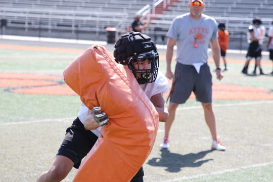 Aztec's Austin Schaub works on tackling drills during practice on Wednesday, Aug. 7 at Fred Cook Stadium in Aztec. The Tigers open the 2019 season at home against Miyamura on Aug. 23.