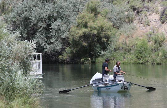 Two anglers fish from a drift boat, Thursday, Aug. 8, 2019, at the Texas Hole on the San Juan River.