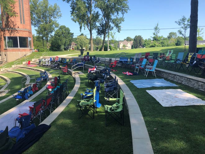 Dozens of chairs were set up-- and left empty-- by about 10:30 a.m. Aug. 1, 2019, more than eight hours before a concert at the LaFontaine Amphitheater in Milford.