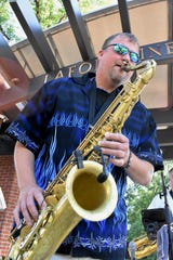 Mainstreet Soul's saxophonist grooves to the beat during the band's Aug. 1 concert at Milford's Central Park.