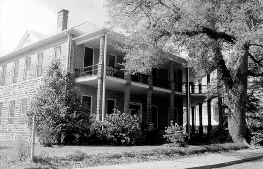 Pictured is the home of Sheriff Marion Swords and family (including his daughter Mary) on the corner of Vine and Liberty streets in Opelousas. The home was built in 1907-08 and is till standing today.