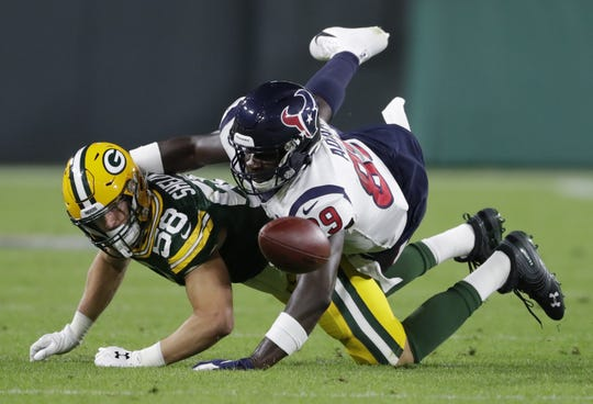 Green Bay Packers linebacker Brady Sheldon (58) breaks up a pass intended for Houston Texans tight end Jerell Adams.