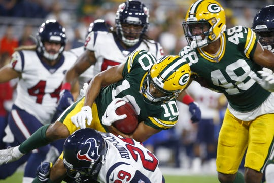 Packers wide receiver Darrius Shepherd (10) tries to hurdle Texans cornerback Briean Boddy-Calhoun (29) in the fourth quarter.