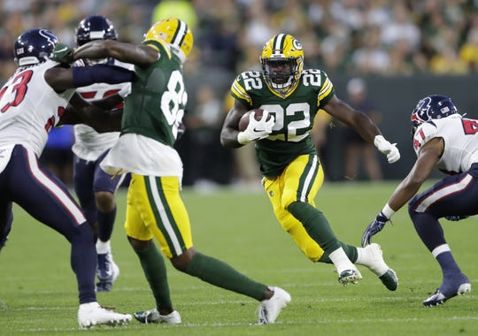 Packers running back Dexter Williams (22) runs for yardage against the Houston Texans in a preseason game on Aug. 8, 2019, at Lambeau Field.