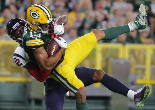 Green Bay Packers wide receiver Allen Lazard (13) scores a touchdown on a 27-yard reception while being covered by Houston Texans cornerback Lonnie Johnson (32) during the third quarter of their pre-season game Thursday, August 8, 2019 at Lambeau Field in Green Bay, Wis.