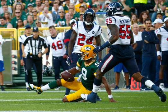 Packers quarterback DeShone Kizer (9) slides to the ground in the first quarter of their preseason game against the Houston Texans Thursday, August 8, 2019 at Lambeau Field in Green Bay, Wis.