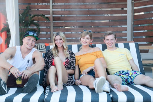 Brittany Creech and her friends sit by the pool at Taco Bell's 'The Bell' hotel in Palm Springs, Calif. on Thursday, August 8, 2019.
