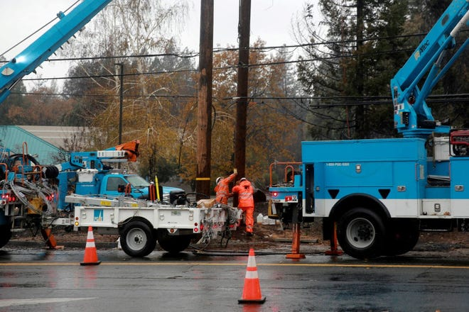 PG&E workers repair a power line