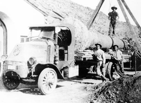 A McKinney family truck, with Eldon McKinney standing on a palm tree, before planting it at the O'Donnell House in 1924.