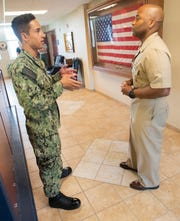 Master Chief Petty Officer Mario Rivers offers Seaman Gavin Olsen some career guidance during an encounter at Naval Air Station Pensacola on Thursday.