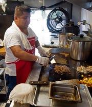 Mauricio Ceda creates authentic Mexican cuisine out of the Tacos El Amigo food truck on Friday.