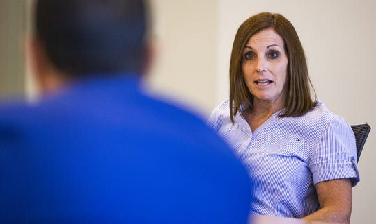 Arizona Republican Senator Martha McSally speaks to Maricopa County Sheriff Paul Penzone during a panel discussion in Phoenix concerning counterfeit drugs and health care, Thursday, August 8, 2019.