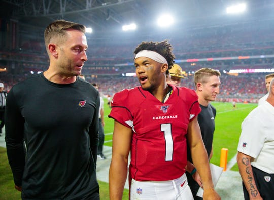 Cardinals coach Kliff Kingsbury talks with quarterback Kyler Murray as they head to the locker room at halftime during a game against the Chargers on Aug. 8 at State Farm Stadium.