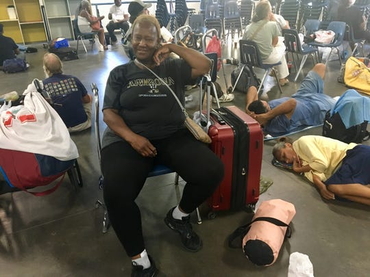 Regina Brown loves movies, and the ones showed daily at the Society of St. Vince de Paul's dining room in Phoenix gives her a chance to see them and stay cool.