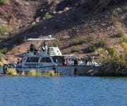Mohave County sheriff's deputies search an area near Lake Havasu where a 28-year-old California man jumped from a cliff and didn't resurface on Aug. 9, 2019.
