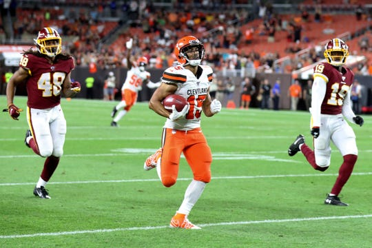 Cleveland Browns' Damon Sheehy-Guiseppi (15) runs 86 yards for a touchdown on a punt return during the second half of the team's NFL preseason football game against the Washington Redskins in Cleveland.