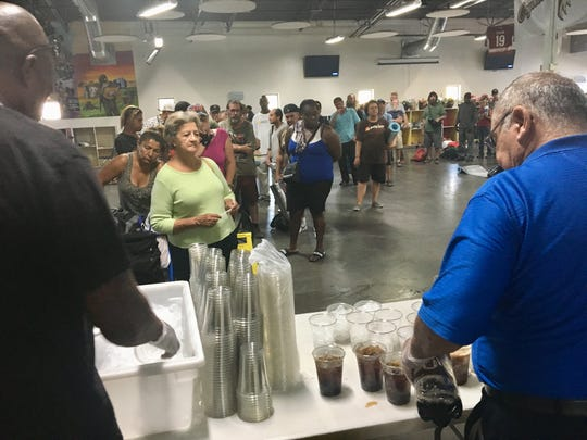 The line at the makeshift concession stand snakes all the way across the Society of St. Vincent de Paul's dining room in Phoenix where the previews had just started on five big-screen televisions.