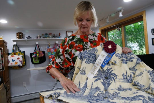 Peggy Norton points out where she matched the pattern on a jacket constructed of vintage toile fabric at her home in Staatsburg on August 7, 2019. Peggy has been entering needlecraft items in the Dutchess County Fair since 2008.