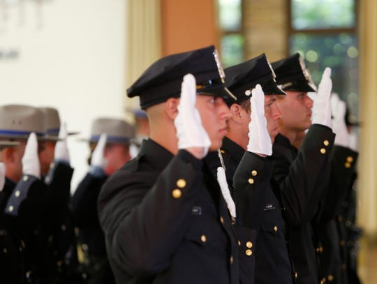 Officers take their oath during the Dutchess County Law Enforcement Academy graduation ceremony on August 9, 2019.