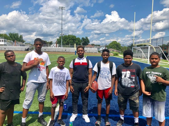 Members of the City of Poughkeepsie Pop Warner football league pose together after a youth football camp at Poughkeepsie High School Saturday. From left: Korey Jackson, Jahi Gary, Tazjir Gary, Damir Parker, Pierre Devaughn and Vincent Murray