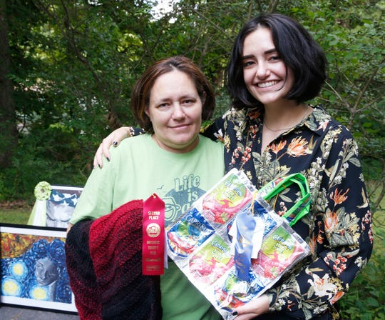 From left, Charlotte and Hannah Apuzzo holding ribbon winning items they have entered into the Dutchess County Fair on at their home in Staatsburg on August 9, 2019.