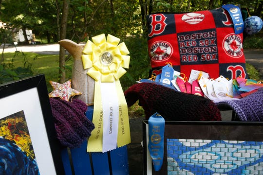 A collection of ribbon winning items the Apuzzo family has entered into the Dutchess County Fair on display at their home in Staatsburg on August 9, 2019.