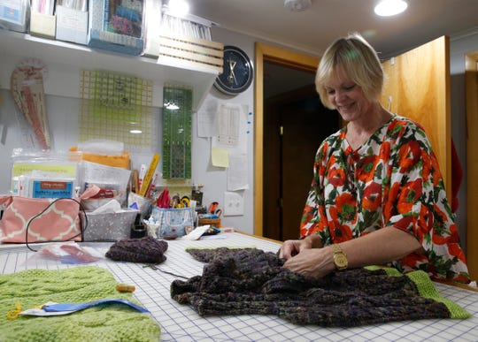 Peggy Norton inspects a sweater she is working on for this year's Dutchess County Fair at her home in Staatsburg on August 7, 2019.