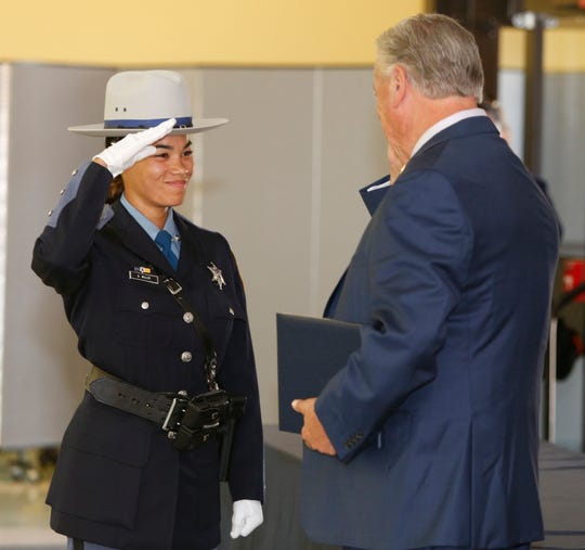 Dutchess County Sheriffs deputy recruit Danesha Miller receives her badge from Sheriff Butch Anderson during the Dutchess County Law Enforcement Academy graduation ceremony on August 9, 2019.