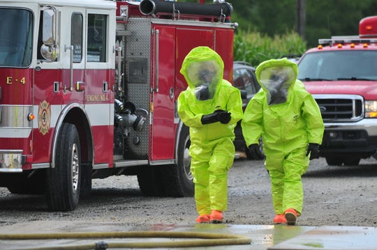 Firefighters in protective gear approach the dangerous zone during a hazardous materials emergency response exercise Thursday, Aug. 8, 2019, at Union County Co-op in Boston.