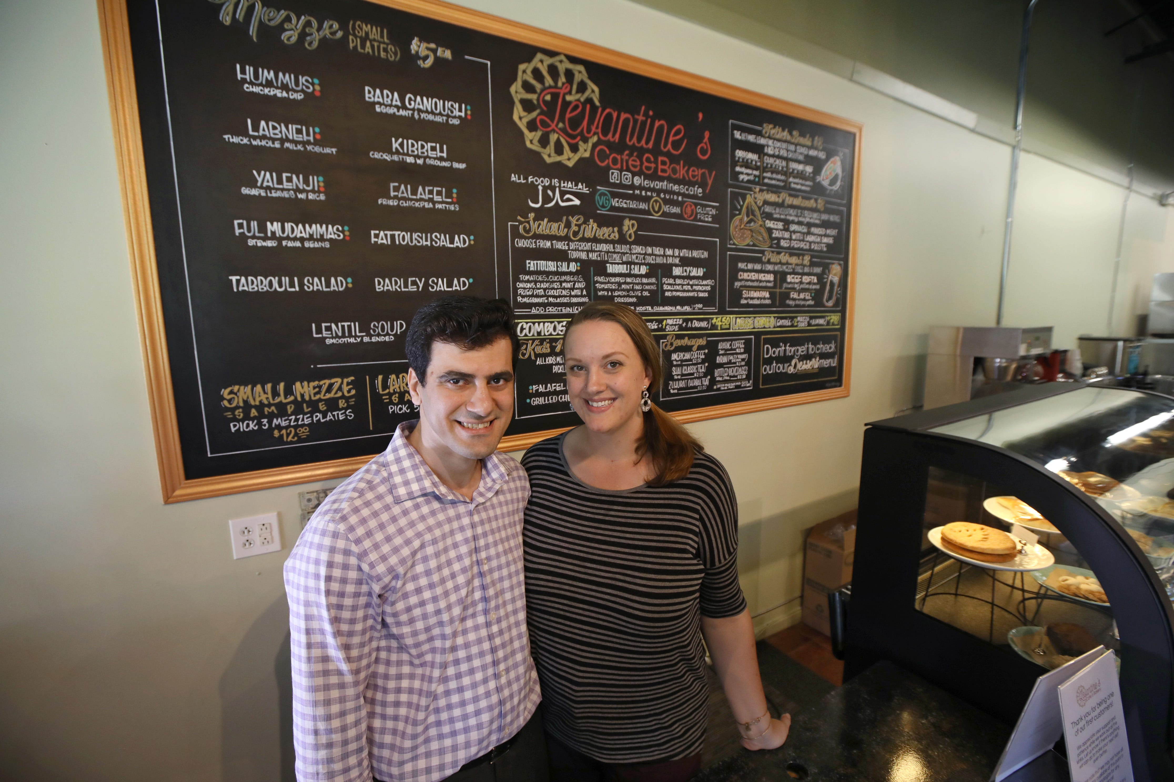 Owners Mohammad and Beth AlFayad behind the counter at their newly opened Levantine's Cafe and Bakery in Gates.