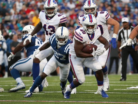 Bills running back Devin Singletary escapes a tackle by Colts Nate Hairston.