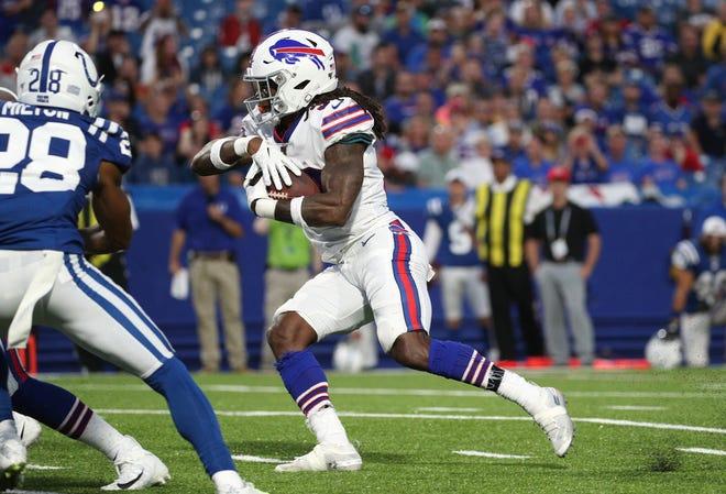 Bills running back T.J. Yeldon looks for running room against the Colts.