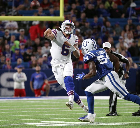 Bills quarterback Tyree Jackson throws off balance as he is pressured by Colts Ahmad Thomas.