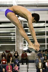 Dhruv Tyagi completing a dive during the Section V Class A Championships. The Fairport diver won the meet with a score of 608.45.