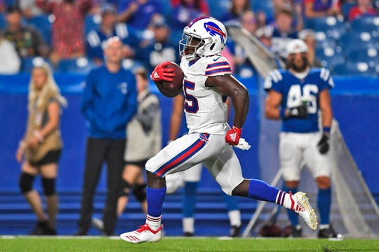 Buffalo Bills' Christian Wade runs the ball for a touchdown during the second half of an NFL preseason football game against the Indianapolis Colts.