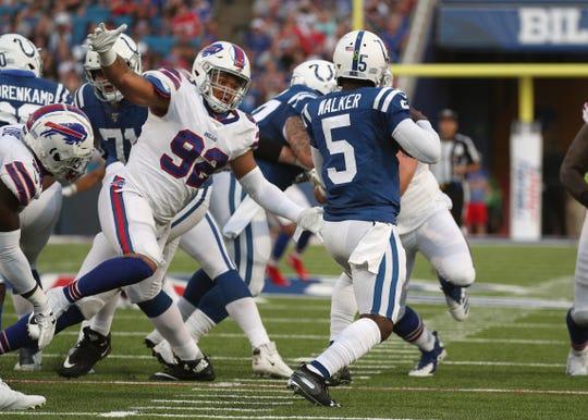 Bills Darryl Johnson closes in on Colts quarterback Phillip Walker for a sack.