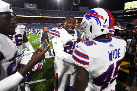 Buffalo Bills' LeSean McCoy, center, celebrates with Christian Wade (45) after Wade scored a touchdown against the Colts.