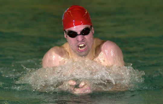 E.J. Amyot swimming the 100-yard breaststroke during a meet against Webster at Fairport in 2001.