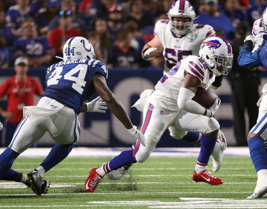 Bills running back Marcus Murphy cuts back against Colts Zaire Franklin.