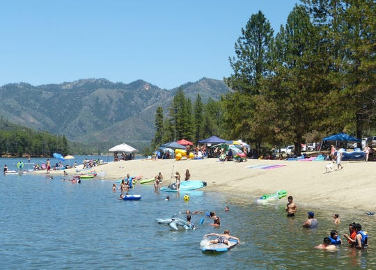 Visitors spend a day at Whiskeytown's Brandy Creek Beach in July of 2016.